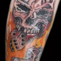 Dice skull in flame tattoo
