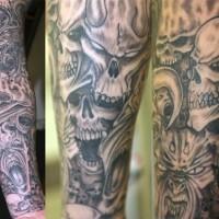 Black skull monsters sleeve tattoo