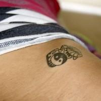 Little black yin yang tattoo