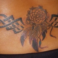 Lowerback tattoo,styled  dream catcher tribal