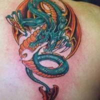 Flying blue fire dragon tattoo