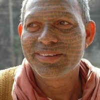 Indian mantras tattoo on face
