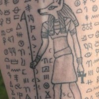 Egyptian hieroglyphics with anubis deity