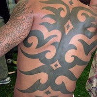 Large full back tribal tattoo