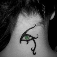 Tribal style green eye tattoo on neck