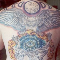 Eye deity with owl and moon tattoo on back