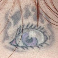 Scared woman eye tattoo