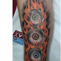 Colourful eyeballs in flame arm tattoo