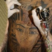 Full back egyptian themed tattoo with pharaoh