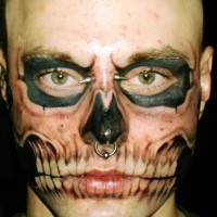 Zombie boy incomplete face tattoo