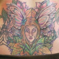 Fairy in flowers large coloued tattoo
