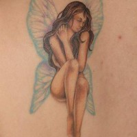 Fairy with crystalline wings on shoulder