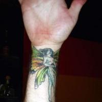 Colourful fairy tattoo on wrist