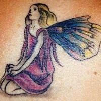 Fairy in sorrow coloured tattoo