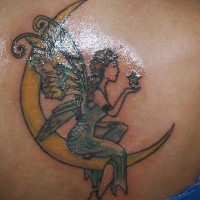 Fairy and moon crescent tattoo