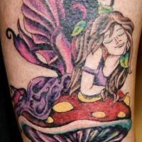 Leg tattoo, dreaming fairy on the mushroom