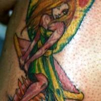 Colourful fairy on mushroom tattoo