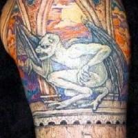 Real gargoyle in window tattoo
