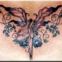 Fairy with tracery coloured tattoo