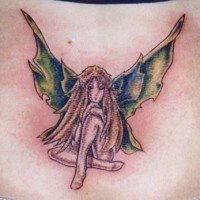 Sad blonde fairy tattoo