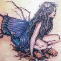 Sad fairy in fallen leaves tattoo