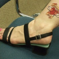 Fell in love female ankle tattoo