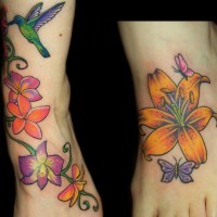 Colourful lilies with hummingbird foot tattoo