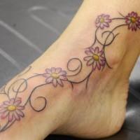 Vine of small chamomile leg tattoo