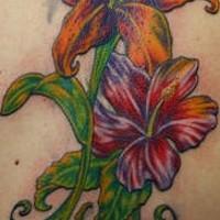 Big colored lilies vine tattoo
