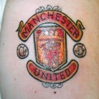 Manchester united crest tattoo