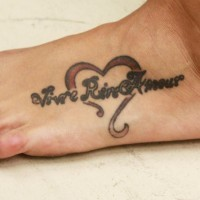 Love styled inscription in heart foot tattoo
