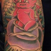 Tatuaggio colorato sul braccio diavoletto nel fiore