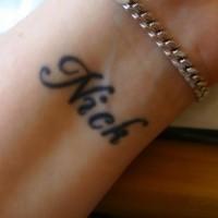 Friendship name tattoo on wrist