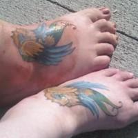 Identical sparrow tattoos on feet