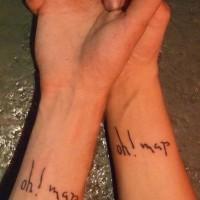 Identical wrist tattoos