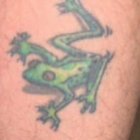 Small green frog crawling tattoo