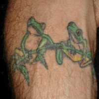Frogs on branch tattoo