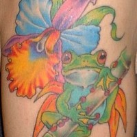 Frog on colourful exotic flower tattoo