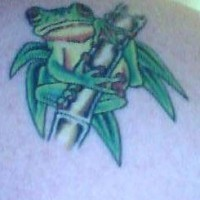 Frog on bamboo tattoo