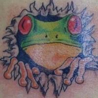 Frog face from under skin tattoo