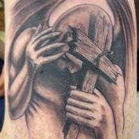 Imp with cross tattoo