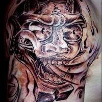Asian fire-breathing beast tattoo