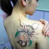 Elegant flower and snake on shoulder