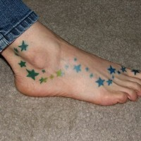 Colorful stars girly tattoo on foot
