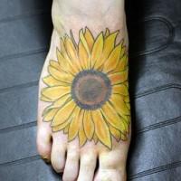 Large sunflower tattoo on foot