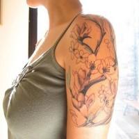 Sakura tree branch shoulder tattoo