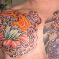 White lotus and purple dragon tattoo on chest