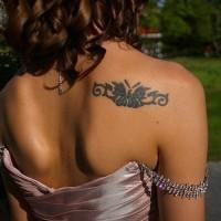 Girly black ink tattoo