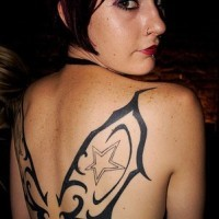 Tribal butterfly wings tattoo on girl back