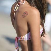 Rolling stones logo on shoulder tattoo